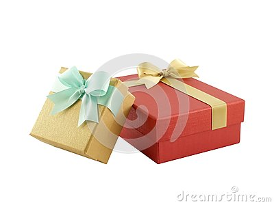 two gift boxes (yellow gold box with mint green ribbon bow and red box with golden ribbon bow) isolated on white