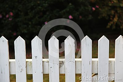 Wooden picket fence in white