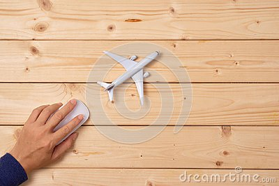 Online travel booking concept. Airplane model and computer mouse