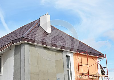 Painting,Plastering, Stucco Exterior House Wall. Facade Thermal Insulation and Painting Repair Works During Exterior Renovations.