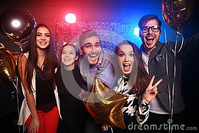 New year party, holidays, celebration, nightlife and people concept - Young people having fun dancing at a party