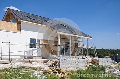 Renovate and repair residential house facade wall with stucco, insulation,plastering, painting wall. House Construction