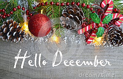 Hello December.Christmas decoration on old wooden background.Winter holidays concept.