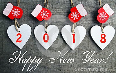 Happy New Year 2018.Decorative white wooden Christmas hearts and red mittens on old wooden background.