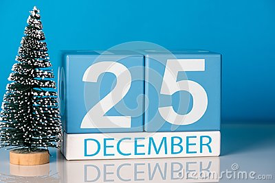 Christmas. December 25th. Day 25 of december month, calendar with little christmas tree on blue background. Winter time