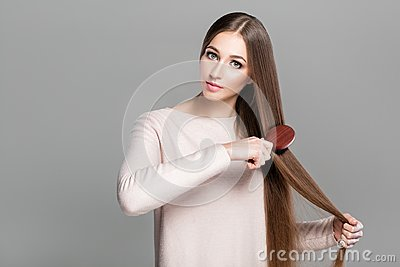 Woman with hairbrush