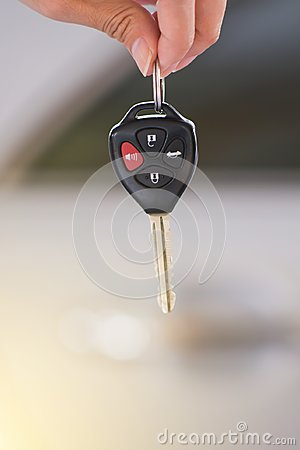 Hand holding remote car key.