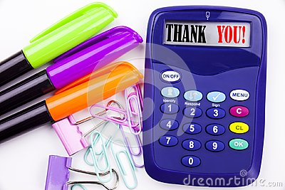 Writing word Thank You text in the office with surroundings such as marker, pen writing on calculator. Business concept for Giving