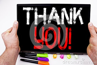 Writing text showing Thank You made in the office with surroundings such as laptop, marker, pen. Business concept for Giving Grati