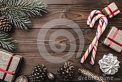 Background. Fir tree, decorative cone. Message space for Christmas and New Year. Sweets and gifts for holidays. colored candies.