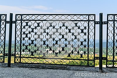 Ironwork metal fence - detail of beautiful decorative manual forged metal fence