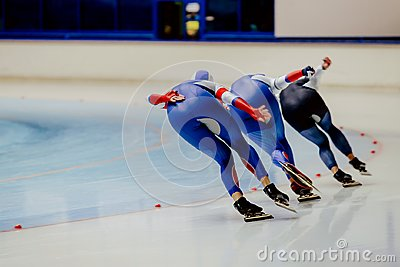 Back three women athletes speed skaters