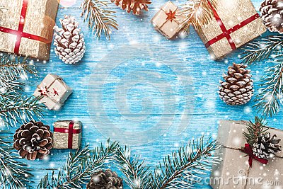 Azure wood background. Green fir branches, con. Christmas greeting card and new year. Space for Santa`s message.