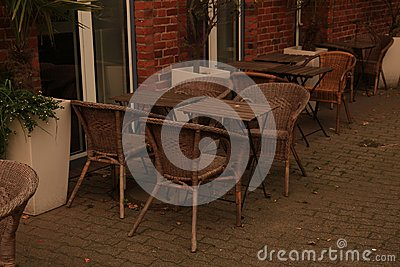 Outdoor cafe with wicker chairs