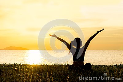 Meditation yoga lifestyle woman silhouette on the Sea sunset, relax vital.