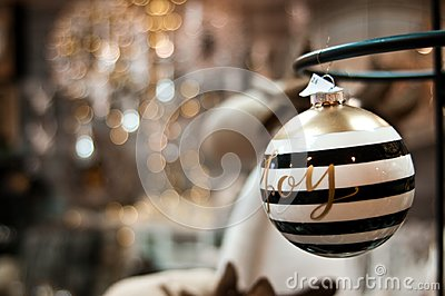 Elegant Christmas bauble with Joy word and bokeh