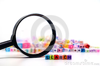 Word `SEARCH` on the magnifying glass with alphabet letter beads background