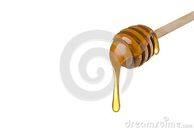 Honey dripping from wooden honey spoon