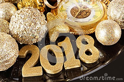 2018 numbers with New Years themed gold decor