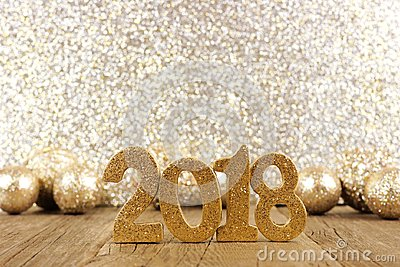 New Years Eve 2018 numbers with baubles and glittery background