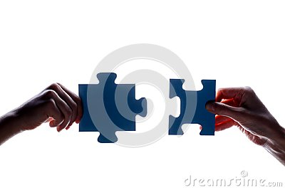 Silhouette of two hand holding couple of blue jigsaw puzzle piece on white background. concept - connection idea, sign, symbol, fr