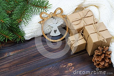 Christmas decoration, gift boxes and angel figure frame background, top view with copy space on white wood table surface. Christma