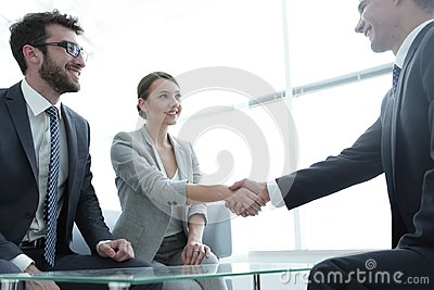 stock image of business lady meets her business partner