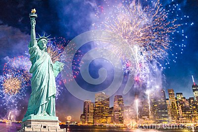 The Statue of Liberty with blurred background of cityscape with beautiful fireworks at night, Manhattan, New York City