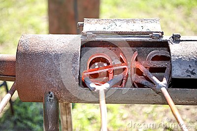 Two branding irons heating in a burner