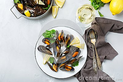 Shellfish mussels with white wine, seafood on a table