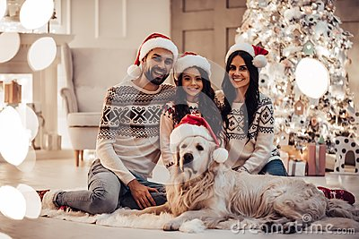 Family with dog on New Year`s Eve