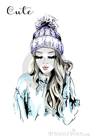 Beautiful young woman in knitted Hat with Fur Pom-Pom.