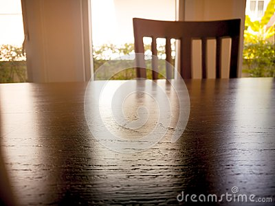 Under expose of wooden din table surface and wooden chair
