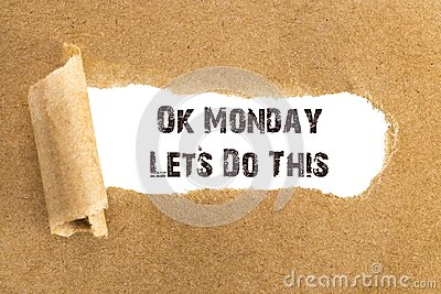 The text Ok Monday Lets Do This appearing behind torn brown pape
