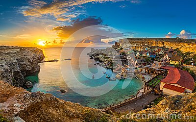 Il-Mellieha, Malta - Panoramic skyline view of the famous Popeye Village at Anchor Bay at sunset