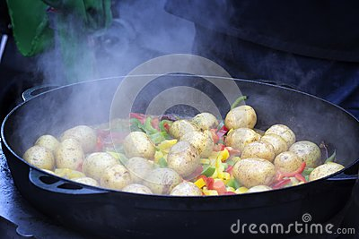 Cooking vegetables in large cast iron cauldron