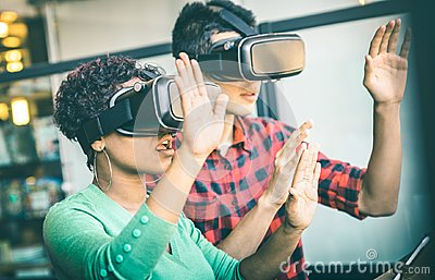 Multiracial couple in love playing with vr virtual reality goggles