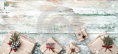 Winter background, with pronounced texture, at the bottom many handmade gifts on white, old wood.