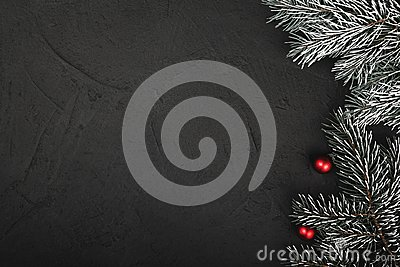 Upper, top view, of Christmas presents on a wooden black rustic background.