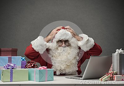 Stressed Santa connecting with his laptop