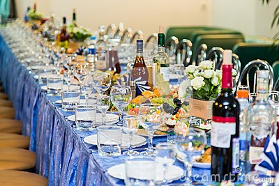 Served tables at the Banquet. Drink, alcohol, delicacies and snacks. Catering. A reception event