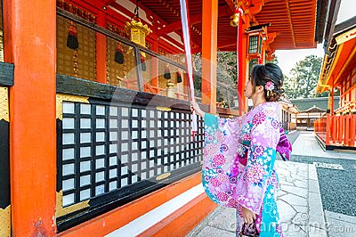 Women in traditional japanese kimonos at Fushimi Inari Shrine in Kyoto, Japan
