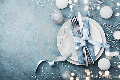 Elegant christmas table setting for holiday dinner top view. Empty space for text. Bokeh effect.
