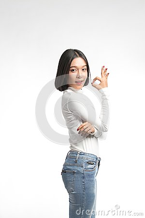 Beautiful  Asian woman making OK sign