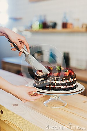 Woman cutting chocolate cake
