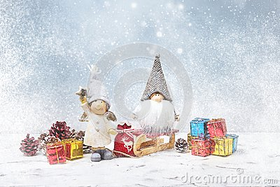 Christmas greeting card. Noel gnomes, small gifts, snow texture.