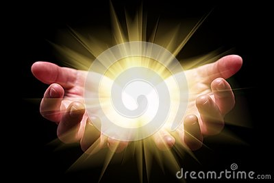 Woman hands cupped holding, showing, or emanating bright, glowing, radiant, shining light.