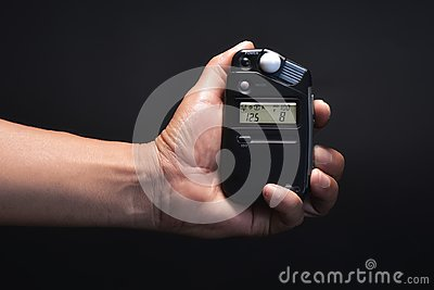 Close up light meter in hand.