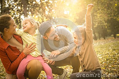 Happy family spending time together outdoors.