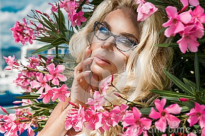 Portrait beautiful phenomenal stunning elegant sexy blonde model woman with perfect face wearing a glasses stands with elegant out